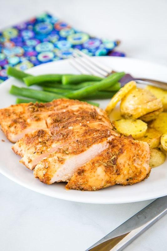 sliced chicken breast on white plate