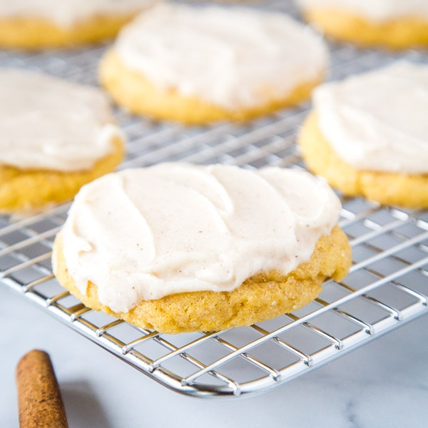 cropped pumpkin sugar cookies on cooling wrack