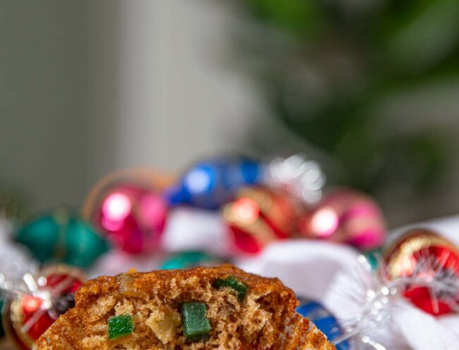 Fruit Cake Muffin with christmas lights behind it