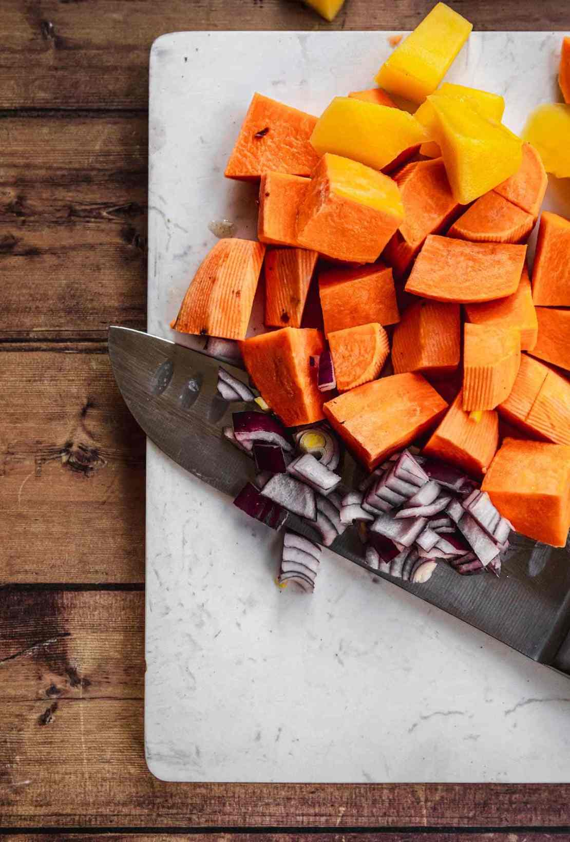 Baked African Sweet Potato Chicken chopped vegetables on cutting board