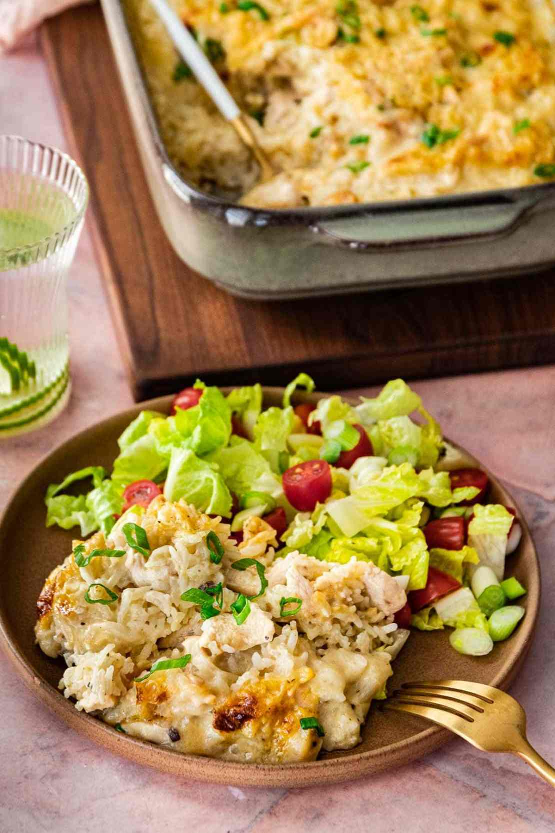 Chicken and Rice Casserole on dinner plate with salad