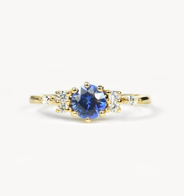 blue sapphire engagement ring in yellow gold