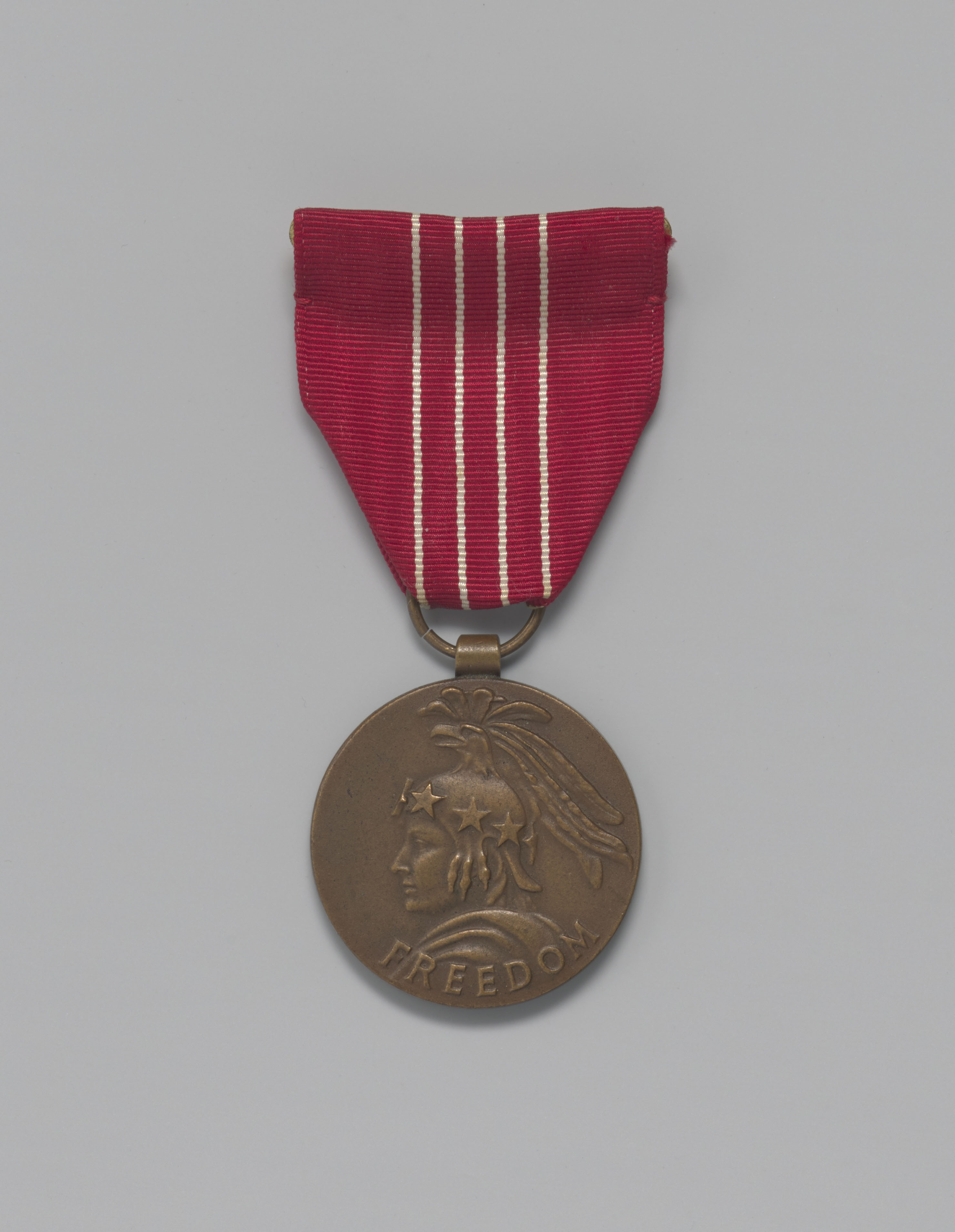 a bronze medal on a gray background