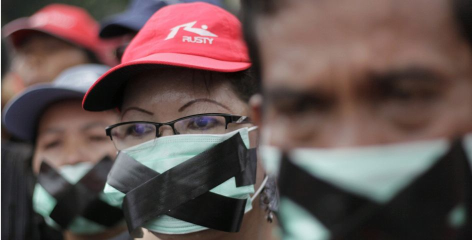 Indonesian Christians have their mouths taped during a protest against rising violence by Islamic hard-liners in Jakarta, Indonesia.