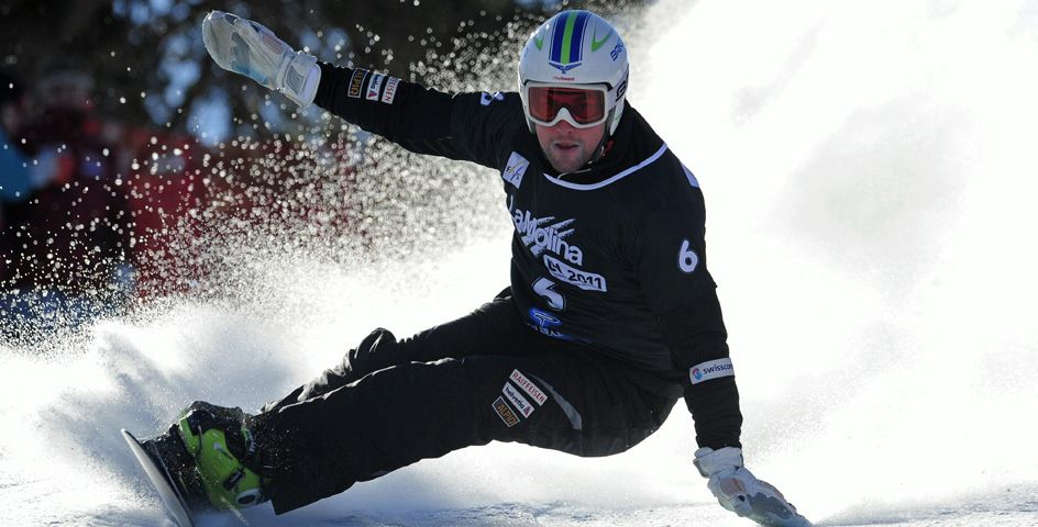 Switzerland's Kaspar Fluetsch competes during the men's Snowboard Parallel Slalom at the FIS Snowboard World Championships in La Molina, Spain.
