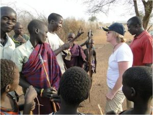 The Deputy Chief of Mission Virginia Blaser chats with Karamajong Warriors.