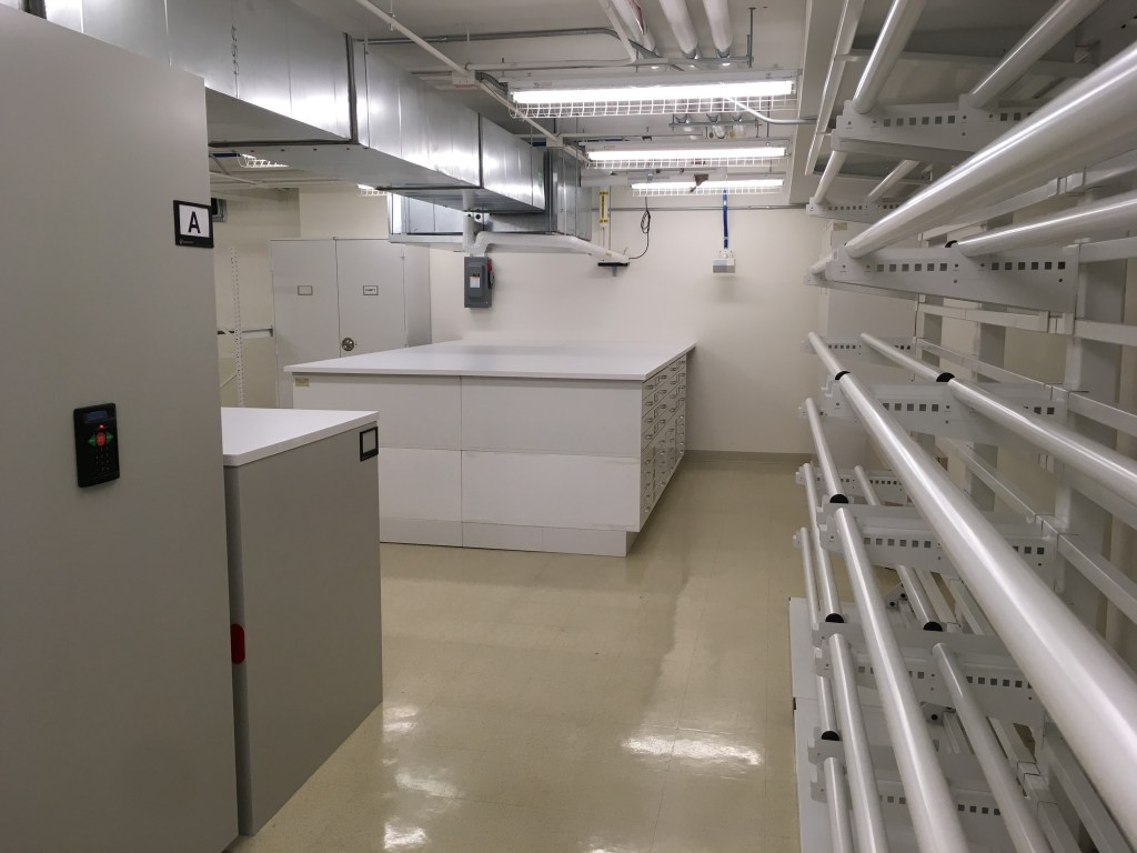 White empty new storage facility with racks