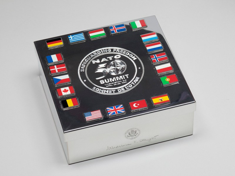"In April 1999, NATO leaders gathered in Washington, D.C. to commemorate the alliance's 50th anniversary. A key theme of the conference was ""Safeguarding Freedom"" as inscribed on this silver lidded box. Secretary Albright gave this gift to her NATO allies at the conference. Collection of the National Museum of American Diplomacy."