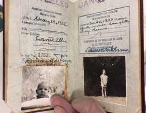 The pages in the passport that include appended photos of Ellis and Lucy's son (left) and daughter (right).