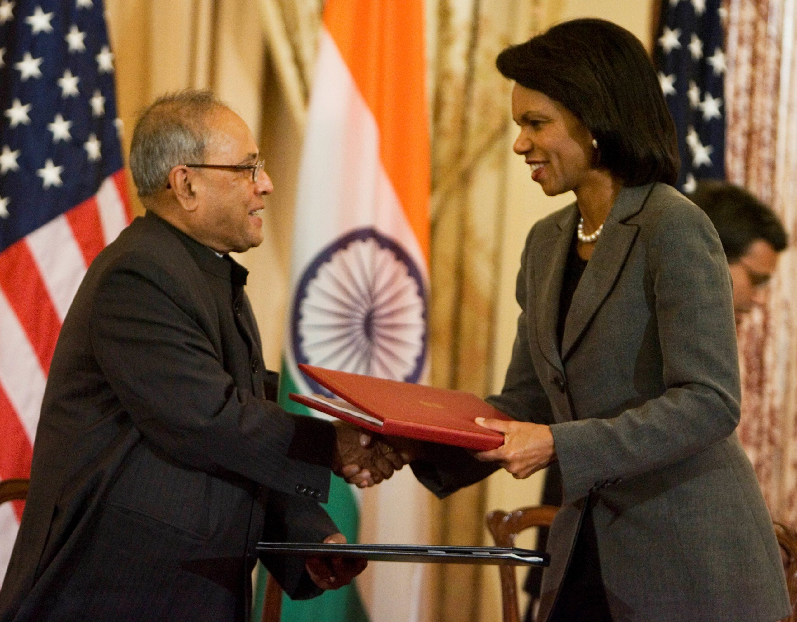 Secretary Rice and Indian Foreign Minister Pranab Mukherjee, shake hands after signing the U.S.-India Agreement for Cooperation Concerning Peaceful Uses of Nuclear Energy at the State Department, Oct. 10, 2008.
