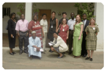 Officials of the U.S. Embassy led by the CPAO Claudia Anyaso (first row, right), pose in a group photo after a mid-year review of Fulbright activities in Nigeria, March 7, 2003