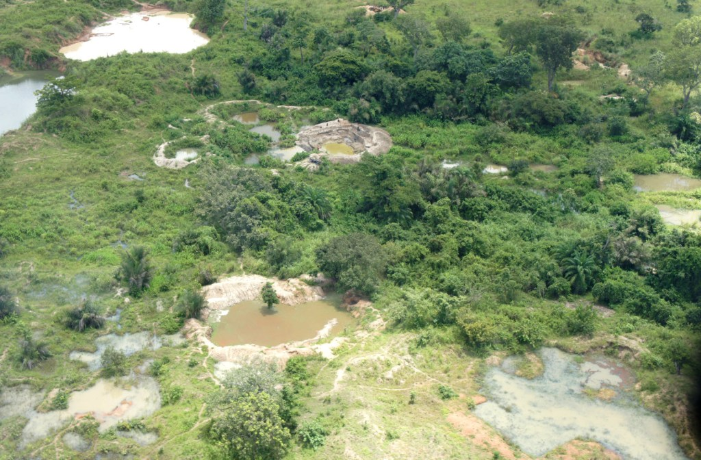 This U.S. Geological Service aerial photo of mine pits in Séguéla, Côte d'Ivoire shows the devastating effects illegal mining can have on the environment.