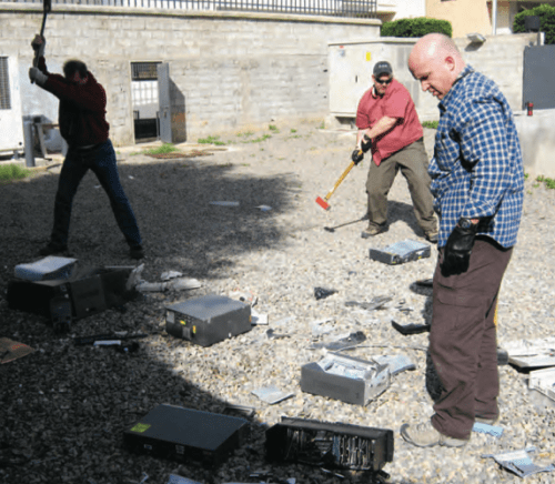 The Regional Security Officer and two Assistant Regional Security Officers destroy electronics at U.S. Embassy Tripoli on February 24, 2011 as they prepare to evacuate the post. (Photo from Diplomatic Security 2011 Year in Review)