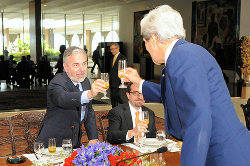U.S. Secretary of State John Kerry and Brazilian Foreign Minister Antonio Patriota share a toast before a working lunch in Brasilia, Brazil, on August 13, 2013. [State Department photo/ Public Domain]