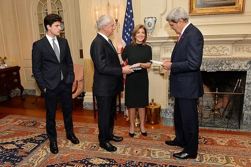 "U.S. Secretary of State John Kerry swears in Caroline Kennedy as U.S. Ambassador to Japan at the U.S. Department of State in Washington, D.C., on November 12, 2013. Ambassador Kennedy is accompanied by her husband, Edwin Schlossberg, and son, John ""Jack"" Schlossberg. [State Department photo/ Public Domain]"