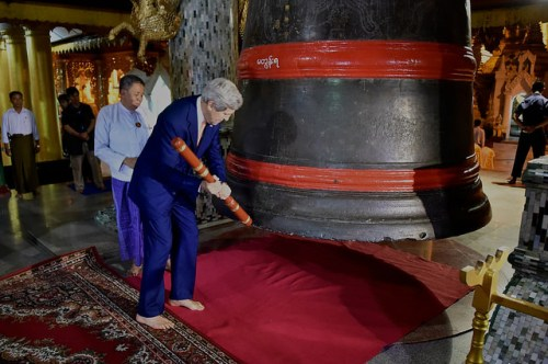 U.S. Secretary of State John Kerry strikes a bell three times while visiting the Buddhist Shwedagon Pagoda in Rangoon, Burma, on August 10, 2014. [State Department photo/ Public Domain]