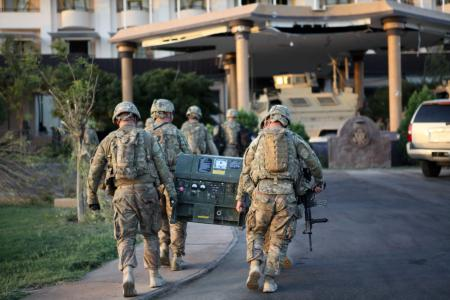 U.S. Soldiers with Delta Company, 1st Battalion, 5th Cavalry Regiment, 2nd Brigade Combat Team, 1st Cavalry Division, carry equipment into the U.S. Consulate in Herat province, Afghanistan, Sept. 14, 2013. Delta Company collaborated with other security and military forces to ensure security for the members of the U.S. Consulate after an enemy attack. (U.S. Army photo by Spc. Ryan D. Green/Released)