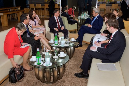 U.S. Secretary of State John Kerry and Cuban Foreign Minister Bruno Rodríguez, flanked by their respective advisers, sit together on April 9, 2015, in Panama City, Panama, during a bilateral meeting - the first between officials at their level since 1958 - on the sidelines of the Summit of the Americas. [State Department photo/ Public Domain