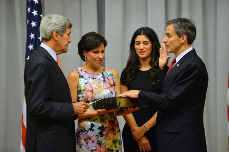 U.S. Secretary of State John Kerry swears in Paul Jones as the next U.S. Ambassador to Poland at the U.S. Department of State in Washington, D.C., on September 11, 2015. [State Department photo/ Public Domain]