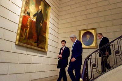 U.S. Secretary of State John Kerry, accompanied by State Department Deputy Chief of Staff Tom Sullivan, walks through the U.S. Embassy in Paris, France, after addressing members of the bilateral Mission, UNESCO, USOECD and their families on November 17, 2015. [State Department photo/ Public Domain]