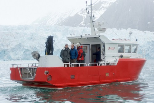 """The research vessel """"Teisten,"""" carrying U.S. Secretary of State John Kerry and Norwegian Foreign Minister Borge Brende, floats on the Kongsfjorden in Ny-Alesund, Norway, the northernmost civilian settlement in the world, as the two leaders inspect the Blomstrand Glacier to see the effects of global warming on the Arctic environment on June 16, 2016. [State Department photo/ Public Domain]"""