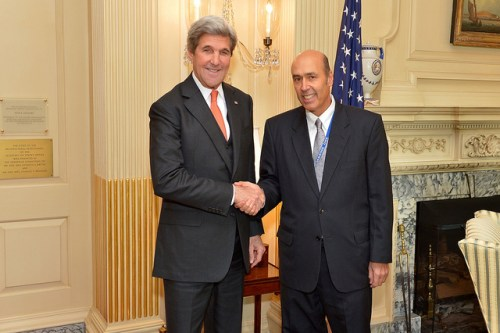 U.S. Secretary of State John Kerry poses for a photo with Ambassador Hugo Llorens at the U.S. Department of State in Washington, D.C., on November 21, 2016. Ambassador Llorens, formerly the Consul General at the U.S. Consulate in Sydney, Australia, will become the new Chargé d' Affaires at the U.S. Embassy in Kabul, Afghanistan. [State Department photo/ Public Domain]