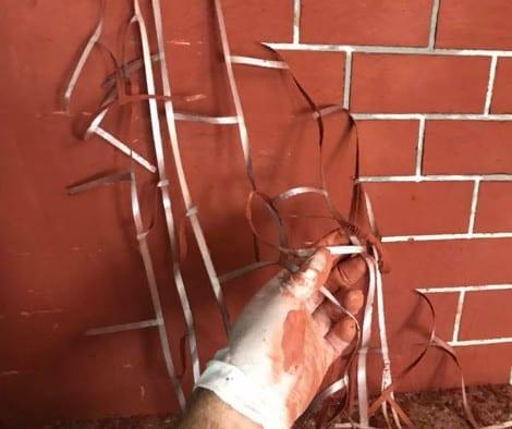 "DIY faux brick wall stencil using 1/2"" masking tape"