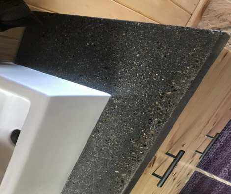 Integrally Colored Concrete Vanity with Smokestack Pigment and Stone Aggregate