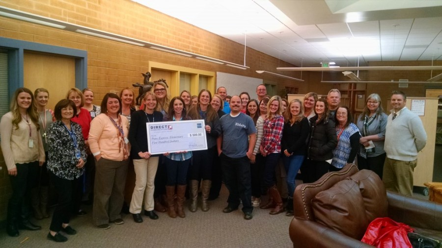 The staff of Pony Express Elementary with a check from Direct Communications