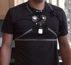 Man wearing the device adjacent to the logo of the My Air My Health Challenge
