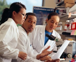 Young scientists having a discussion in a laboratory setting