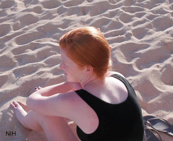 Redheaded girl on a beach