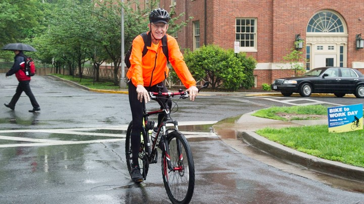 Dr. Collins riding a bicycle to work