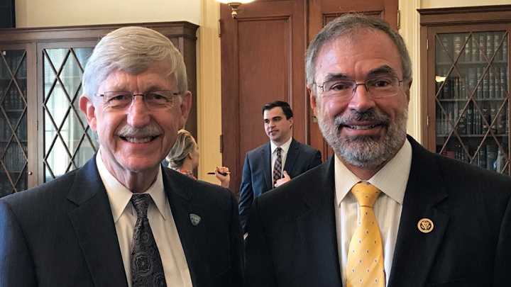 Francis Collins and Congressman Andy Harris pose together at a meeting