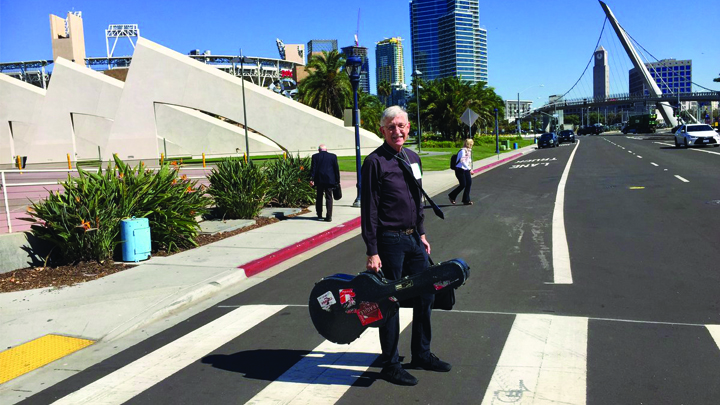 Francis Collins standing in a crosswalk