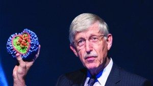 Franics Collins holding a flu virus model