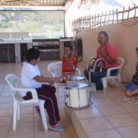 Practicing in the third-floor palapa stage