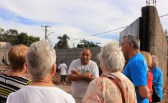 Brother Gerard explains his vision to potential volunteers from San Carlos