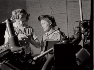 These young female workers were among the first women ever to operate a centerless grinder machine in a Midwest tool factory, 1942. (Library of Congress)