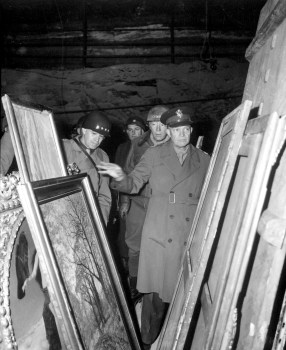 General Dwight D. Eisenhower, Supreme Allied Commander, accompanied by Gen. Omar N. Bradley, and Lt. Gen. George S. Patton, Jr., inspects art treasures stolen by Germans and hildden in salt mine in Germany. April 12, 1945. Lt. Moore. (Army) NARA FILE #: 111-SC-204516 WAR & CONFLICT BOOK #: 1099