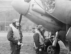 Operation OYSTER, the daylight attack on the Philips radio and valve works at Eindhoven, Holland, by No. 2 Group. Wing Commander H I Edwards VC (left), leader of the De Havilland Mosquito B Mark IVs of Nos. 105 and 139 Squadrons RAF on the raid, and his navigator approach their aircraft before taking off from Marham, Norfolk. C 3304 Part of AIR MINISTRY SECOND WORLD WAR OFFICIAL COLLECTION RAFFPU