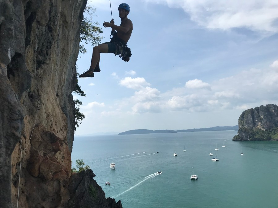 William Nicewonger hanging out on a climb in Thailand