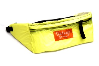Front view of small yellow bumbag made using upcycled paraglider