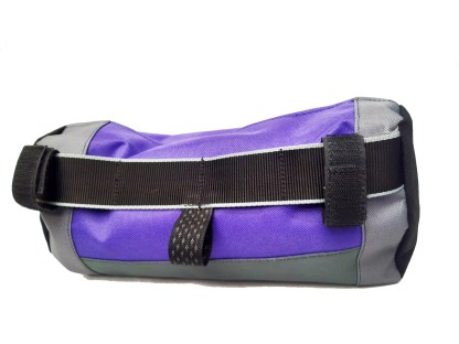 Handle bar bag for a bike, back view. Black webbing and purple fabric