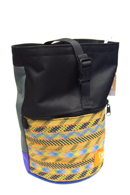 Front view of black boulder bag. Yellow and black pocket made from recycled climbing rope