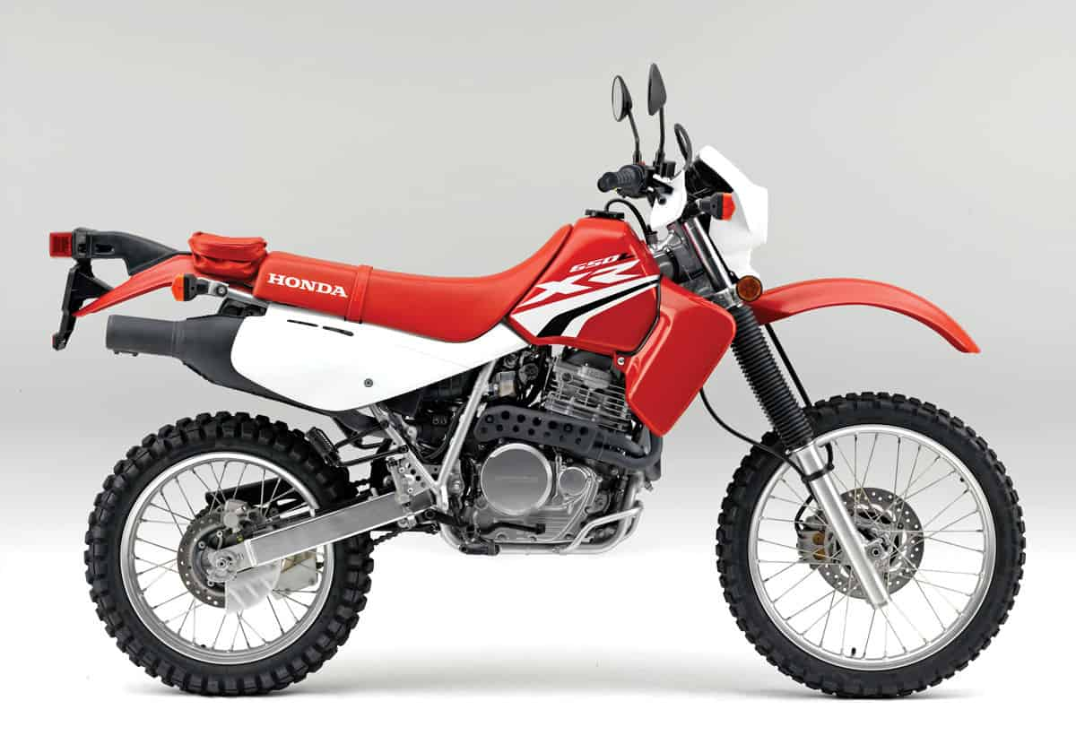 hight resolution of of the three japanese 650cc dual sport bikes the honda is by far the most dirt worthy the air cooled electric start five speed has gone almost unchanged