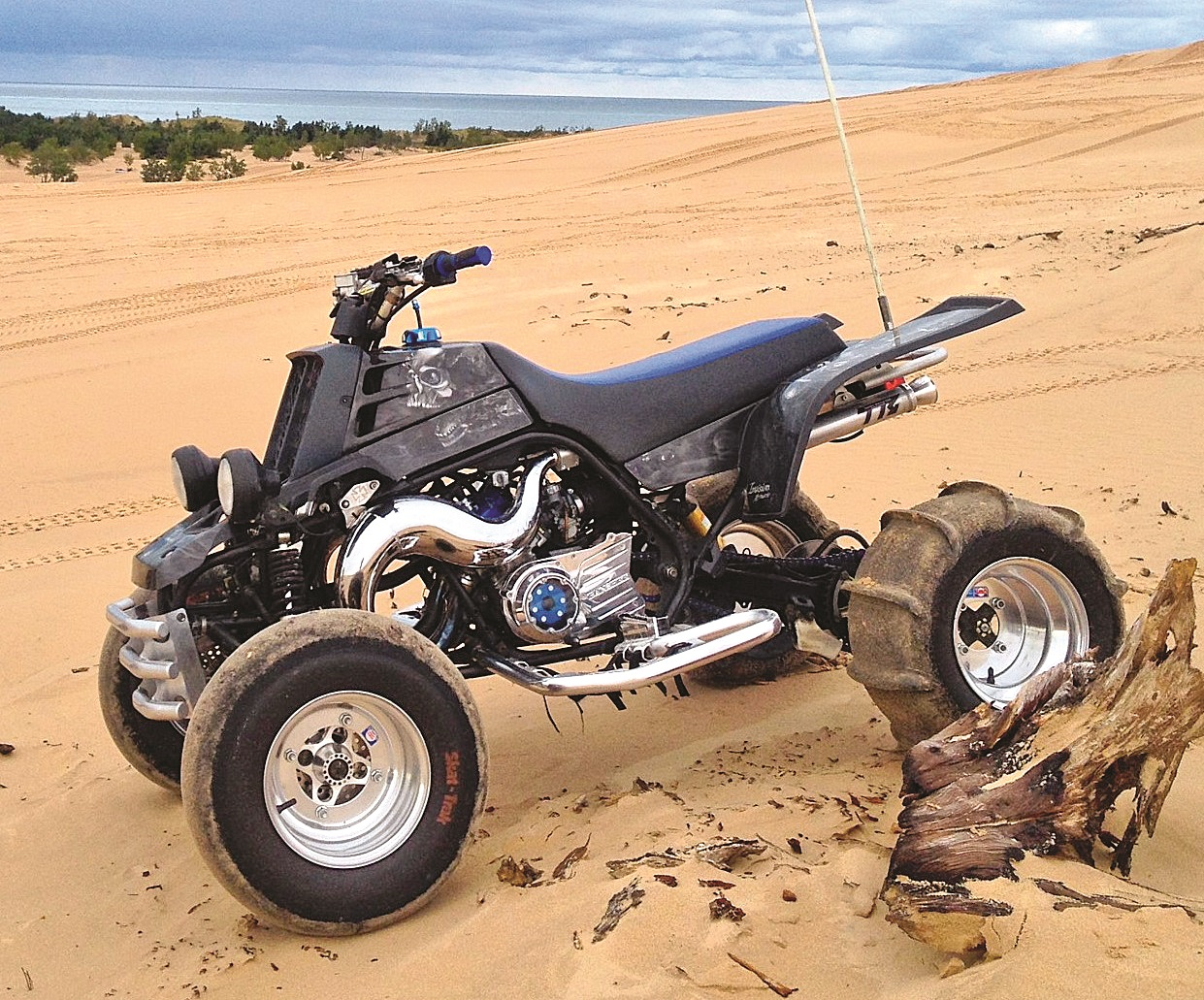 hight resolution of trenton crandall s 2006 special edition banshee sits proudly at michigan s silver lake sand dunes it