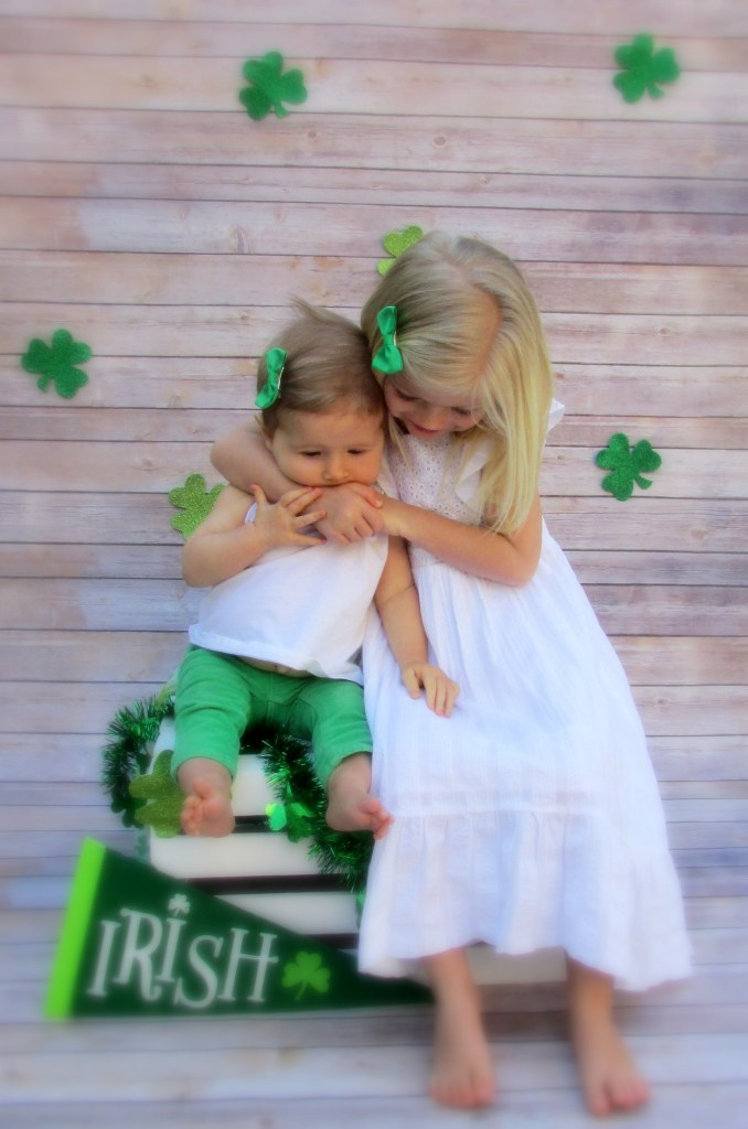 Cute photoboth idea, St. Patrick's Day pictures, St. Patrick's Day photobooth, baby, kids, DIY photobooth, St. Patty's Day, Green, Sisters, clovers,