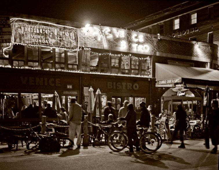 people gather outside the Venice Bistro at night