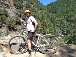 "6'6"" DirtySixer founder riding the Downieville trails on the steel prototype."